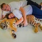 Snuggling a Tiger Cub